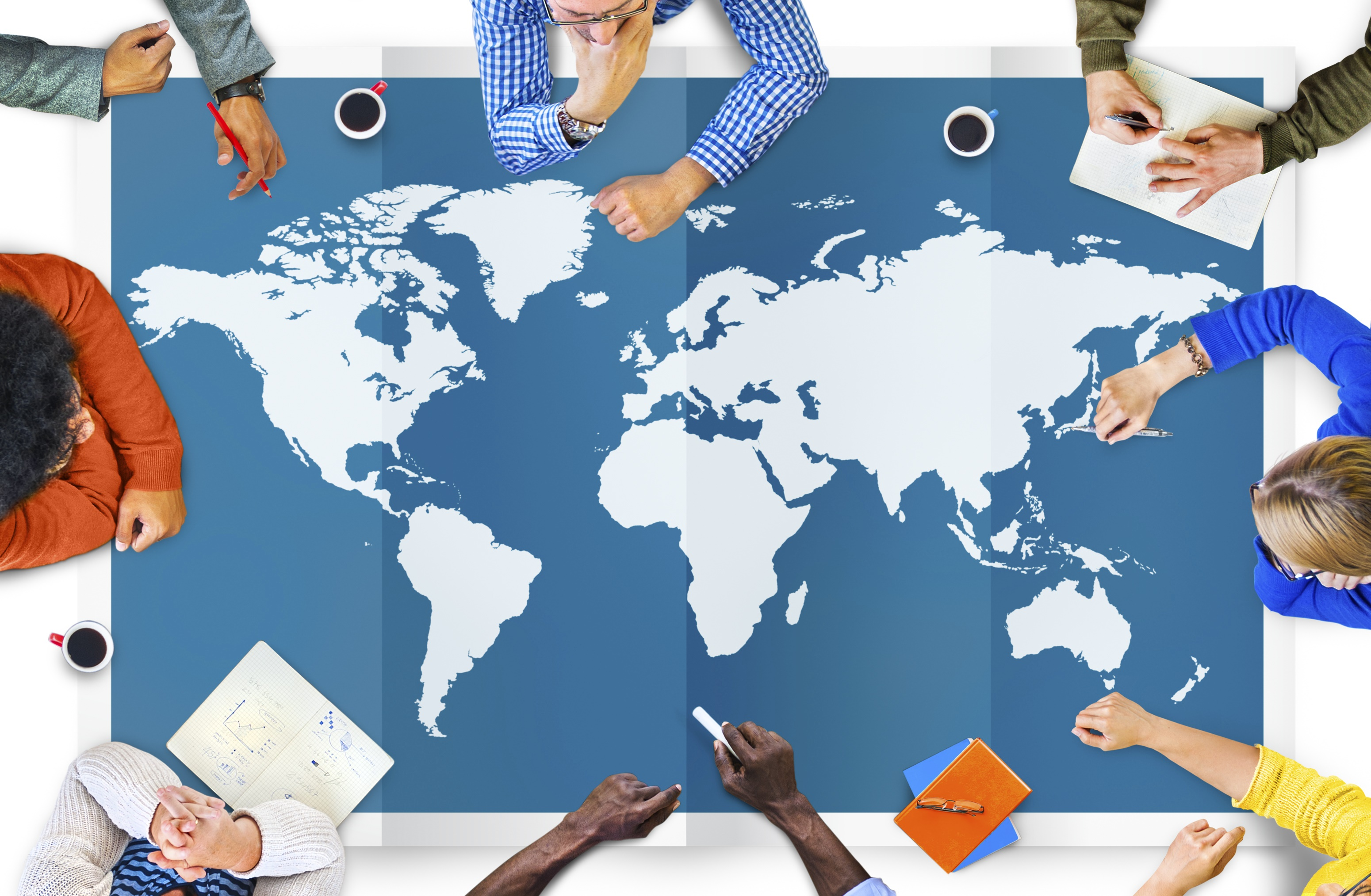 International_Business_People_Around_a_Map